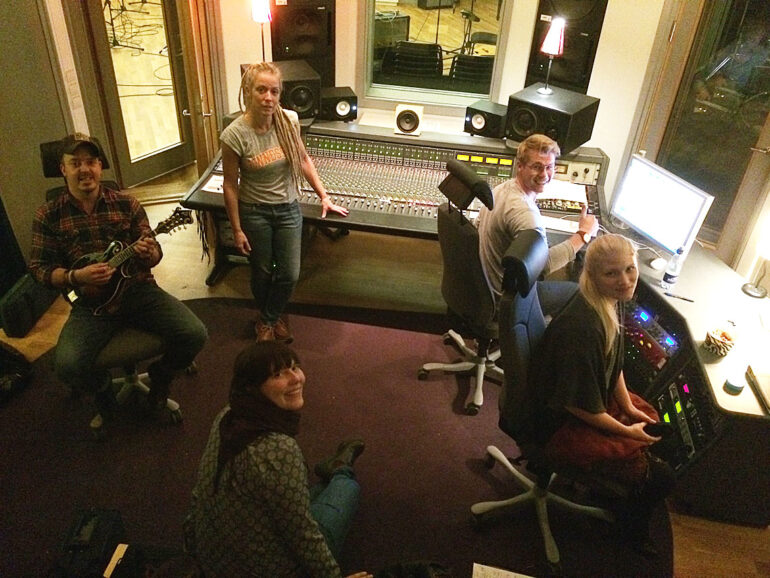 Members from Downhill Bluegrass Band in the studio with Good Harvest